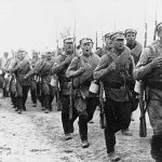 Soldiers sing as they march during the Russian Civil War.
