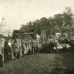 A communist funeral in the 1930s. No priests or incense but some large banners and an armed honour guard.
